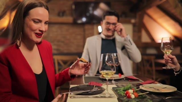 beautiful woman laughing during dinner - red lipstick stock videos & royalty-free footage