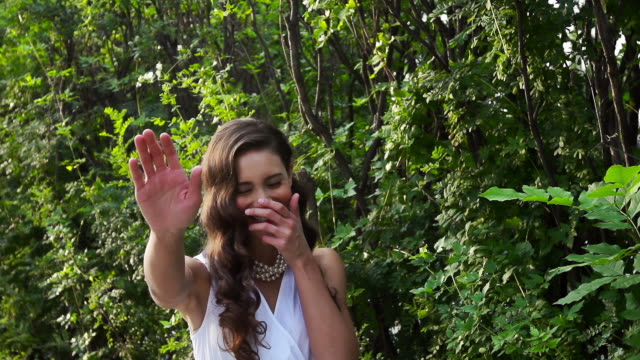 beautiful woman laughs - hands covering mouth stock videos and b-roll footage