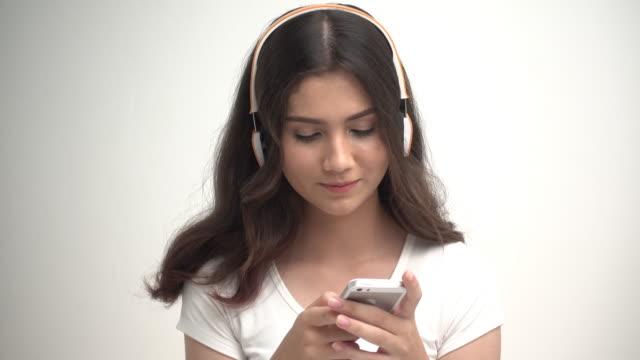 Beautiful woman listing to music