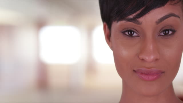 beautiful woman looking at camera - african american culture stock videos & royalty-free footage