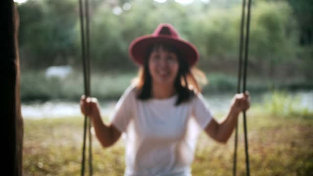 beautiful woman on a swing - white shirt stock videos & royalty-free footage