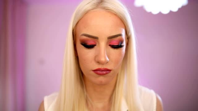 beautiful woman putting lipstick - side hustle stock videos & royalty-free footage