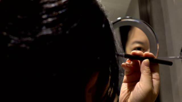 beautiful woman putting makeup on eyebrow - eyebrow stock videos & royalty-free footage