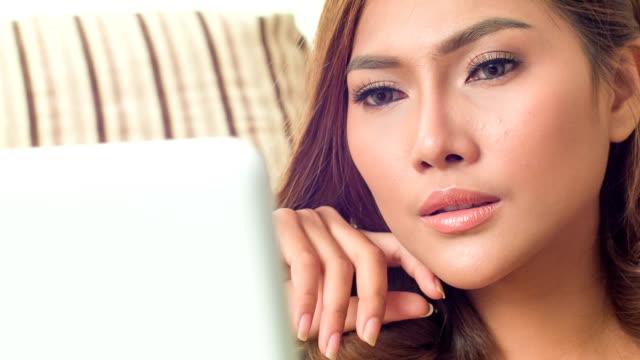 beautiful woman reading on laptop
