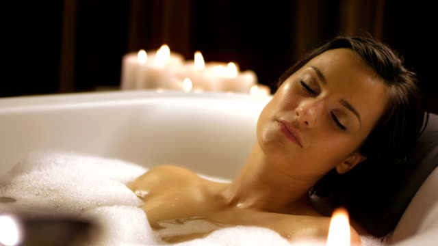 hd: beautiful woman relaxing in bubble bath - bathtub stock videos & royalty-free footage
