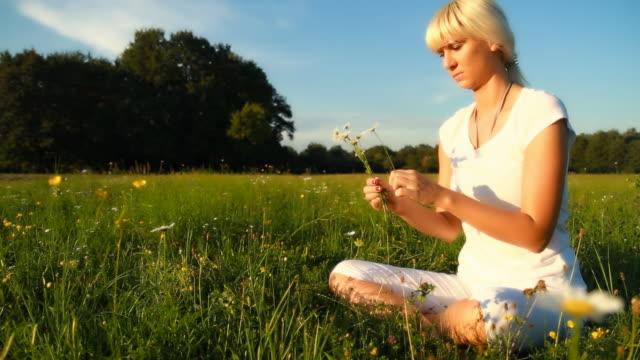 HD DOLLY: Beautiful Woman Relaxing In Meadow