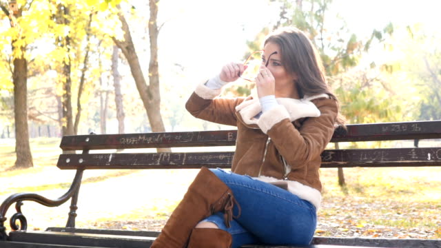 beautiful woman relaxing in park - leather jacket stock videos & royalty-free footage