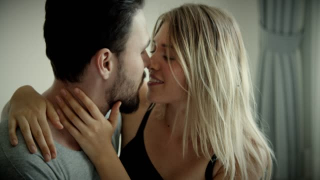 beautiful woman relaxing in romantic husband's arms at home - human sexual behaviour stock videos & royalty-free footage