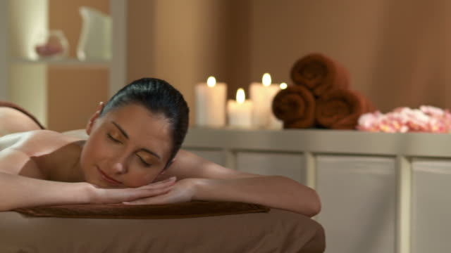 hd: beautiful woman relaxing in spa center - massage table stock videos & royalty-free footage