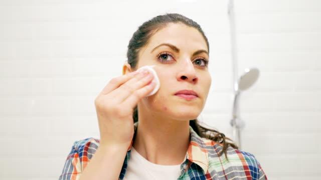 Beautiful woman removing make up