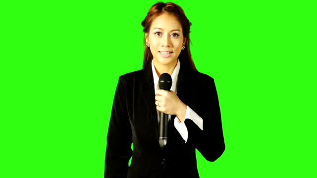 Beautiful Woman Reports The News With Green Screen Background