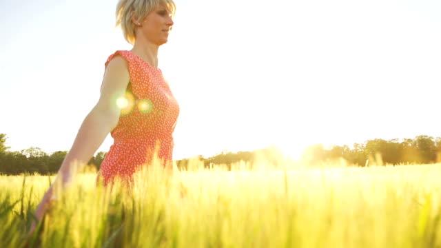 HD SUPER SLOW MO: Beautiful Woman Running In Field