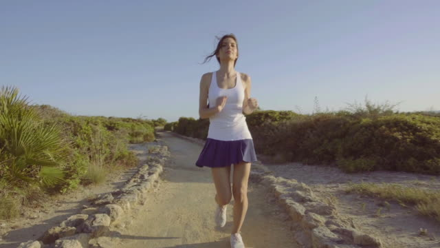 Beautiful woman running in the afternoon