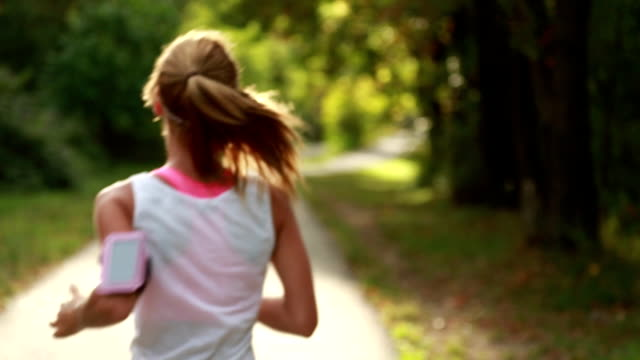 Beautiful woman running in the park