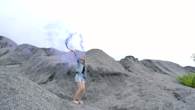 beautiful woman she is playing a fireworks smoke color in the place of the rock grand canyon - flaming torch stock videos & royalty-free footage