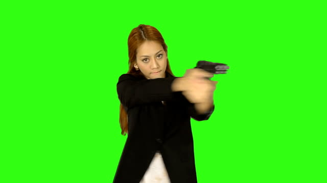 beautiful woman shooting gun with green screen background - keyable stock videos & royalty-free footage