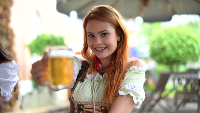 beautiful woman showing beer - german culture stock videos & royalty-free footage