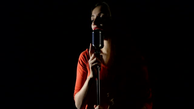 beautiful woman singing to the microphone in a studio - singer stock videos & royalty-free footage