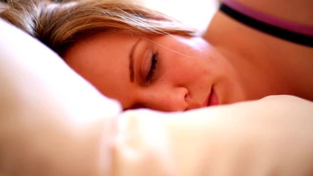 beautiful woman sleeping in bed - blanket stock videos & royalty-free footage