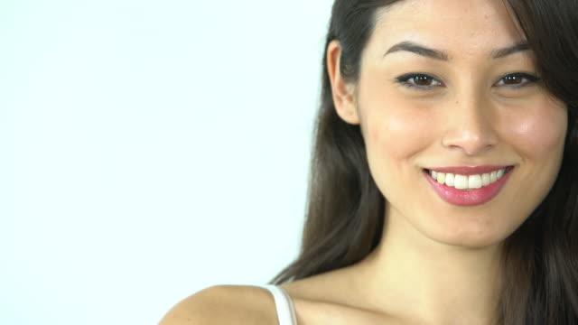 CU beautiful woman smiling and nodding.