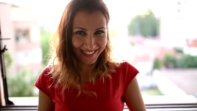 beautiful woman taking photo and smiling - headshot stock videos & royalty-free footage
