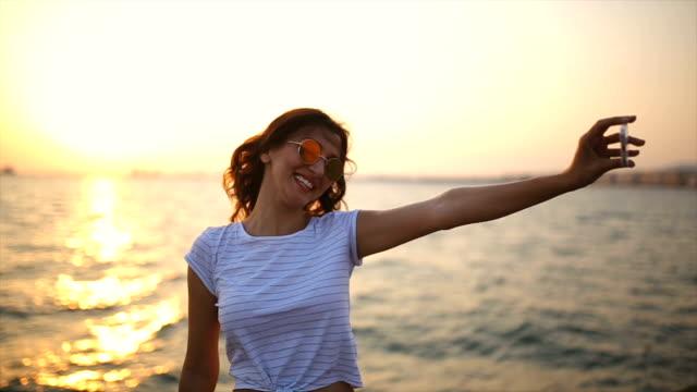 Beautiful woman taking Selfie by the sea