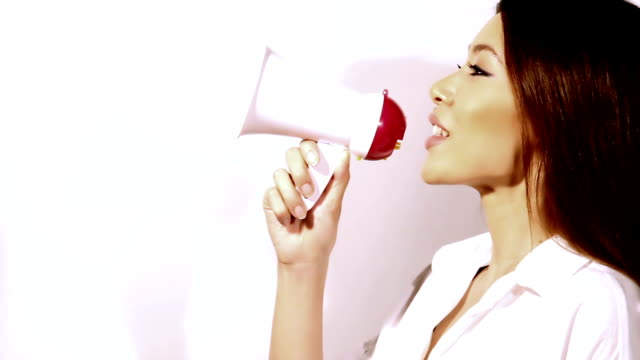 beautiful woman talking non-stop with megaphone v1 - megaphone stock videos & royalty-free footage