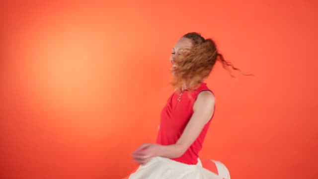 beautiful woman twirling around - coloured background stock videos & royalty-free footage