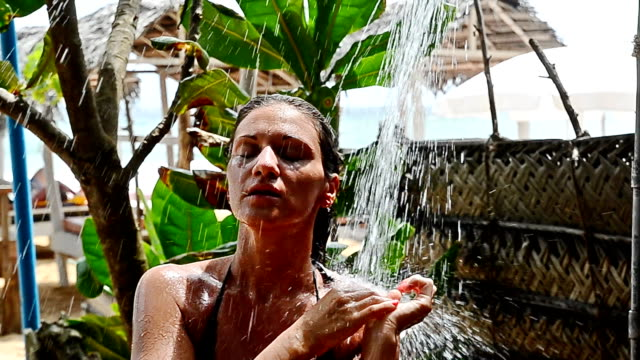 beautiful woman under the shower - spa treatment stock videos & royalty-free footage
