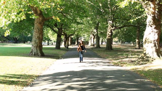 Beautiful Woman Walking in a Park