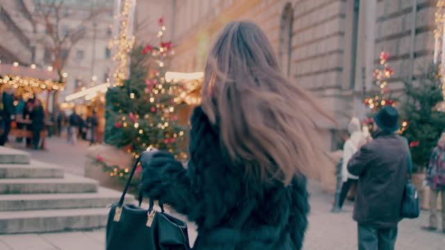 beautiful woman walking into christmas market - advent stock videos & royalty-free footage