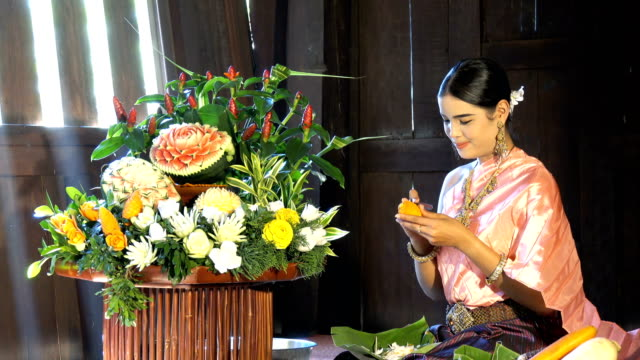 beautiful woman wear traditionnel thai dress carving carrot - 4k - carving food stock videos and b-roll footage