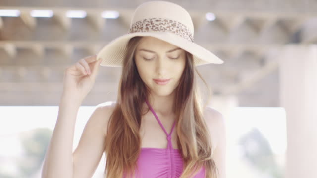 Beautiful woman wearing a summer hat