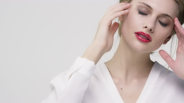 beautiful woman wearing red lipstick and eyeshadow - red lipstick stock videos & royalty-free footage