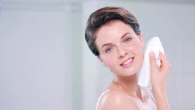beautiful woman with a muslin face cloth. - short hair stock videos & royalty-free footage