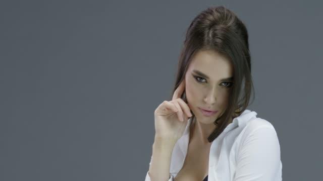 Beautiful woman with natural make-up. Perfect fashion models face. Fashion video.