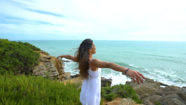 beautiful woman with the arms raised alone in nature - long hair stock videos and b-roll footage