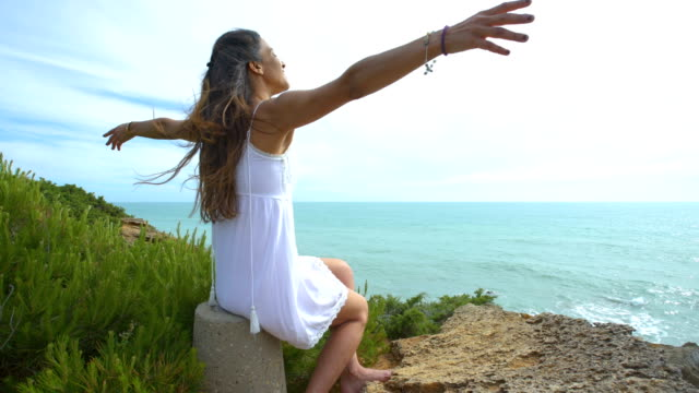 beautiful woman with the arms raised alone in nature - one mid adult woman only stock videos & royalty-free footage