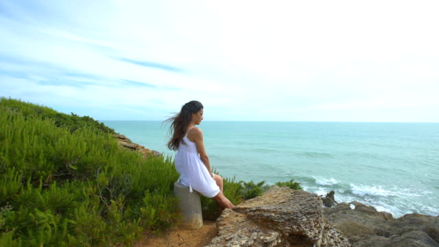 beautiful woman with the arms raised alone in nature - colombian ethnicity stock videos & royalty-free footage