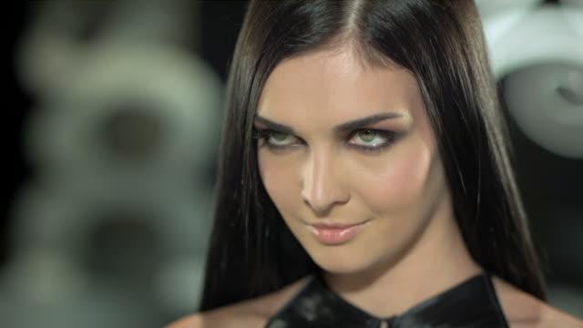 a beautiful woman's intense gaze. - long hair stock videos & royalty-free footage