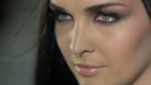 a beautiful woman's intense gaze. - fashion model stock videos and b-roll footage