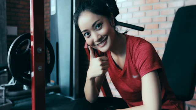 beautiful women a smile for exercising in the gym - slim stock videos & royalty-free footage