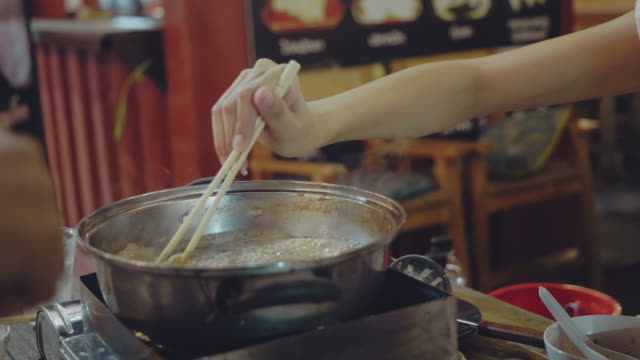 beautiful women enjoy eating hot pot at street night market, - japanese culture stock videos & royalty-free footage