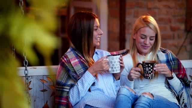 beautiful women enjoying morning coffee - altalena video stock e b–roll