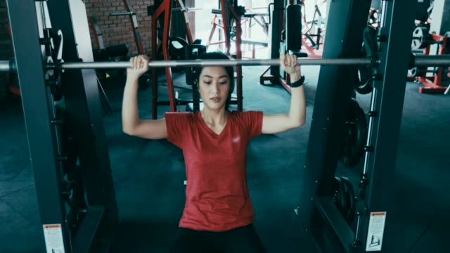 beautiful women for exercising in the gym - bench press stock videos & royalty-free footage