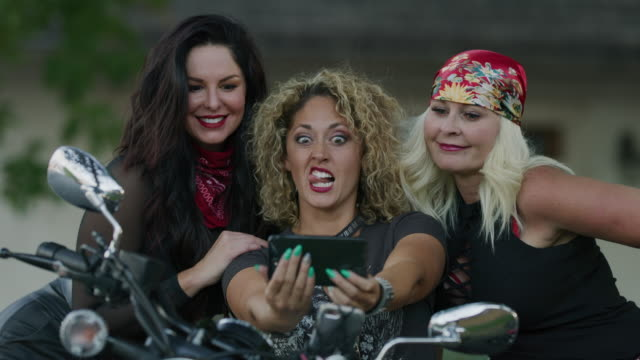 beautiful women on motorcycle making faces for cell phone selfies / payson, utah, united states - digital camera stock videos & royalty-free footage