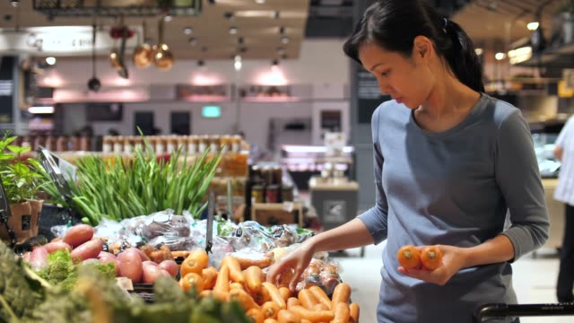 beautiful women shopping carrot vegetables and fruits in supermarket - carrot stock videos & royalty-free footage