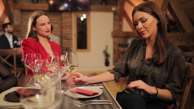 Beautiful women sitting in restaurant