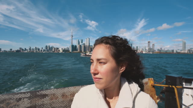 a beautiful women takes a boat to toronto island - waterfront stock videos & royalty-free footage
