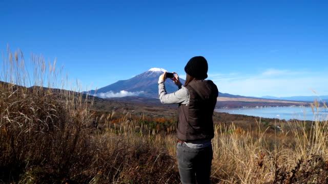 beautiful women taking photos of mt.fuji. - photography stock videos & royalty-free footage